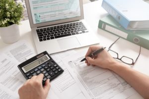 A person works on their small business tax deductions
